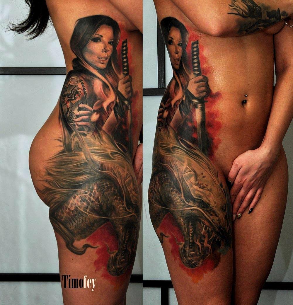 Tattoo von einer Frau mit einem Schwert und einem Drachen