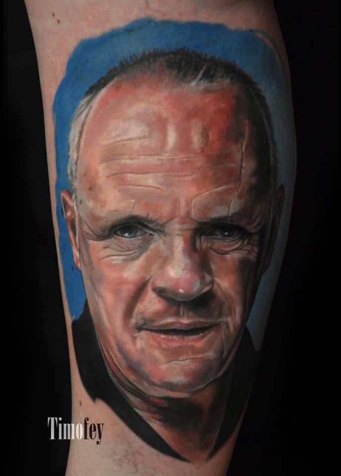 Farbiges Gesicht von einem Mann Tattoo