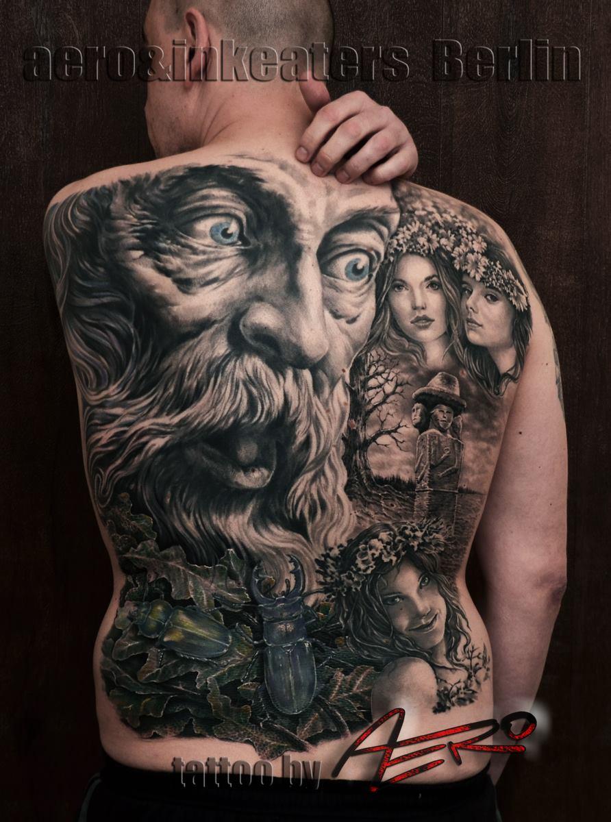 Tattoo über den ganzen Rücken, mit verschieden Gesichtern und einem Maikäfer.