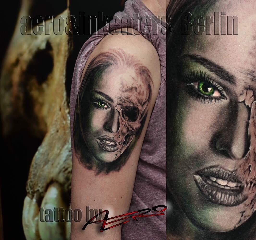 Tattoo von einem weiblichen Gesicht, welches zur Hälfte dämonisch aussieht.