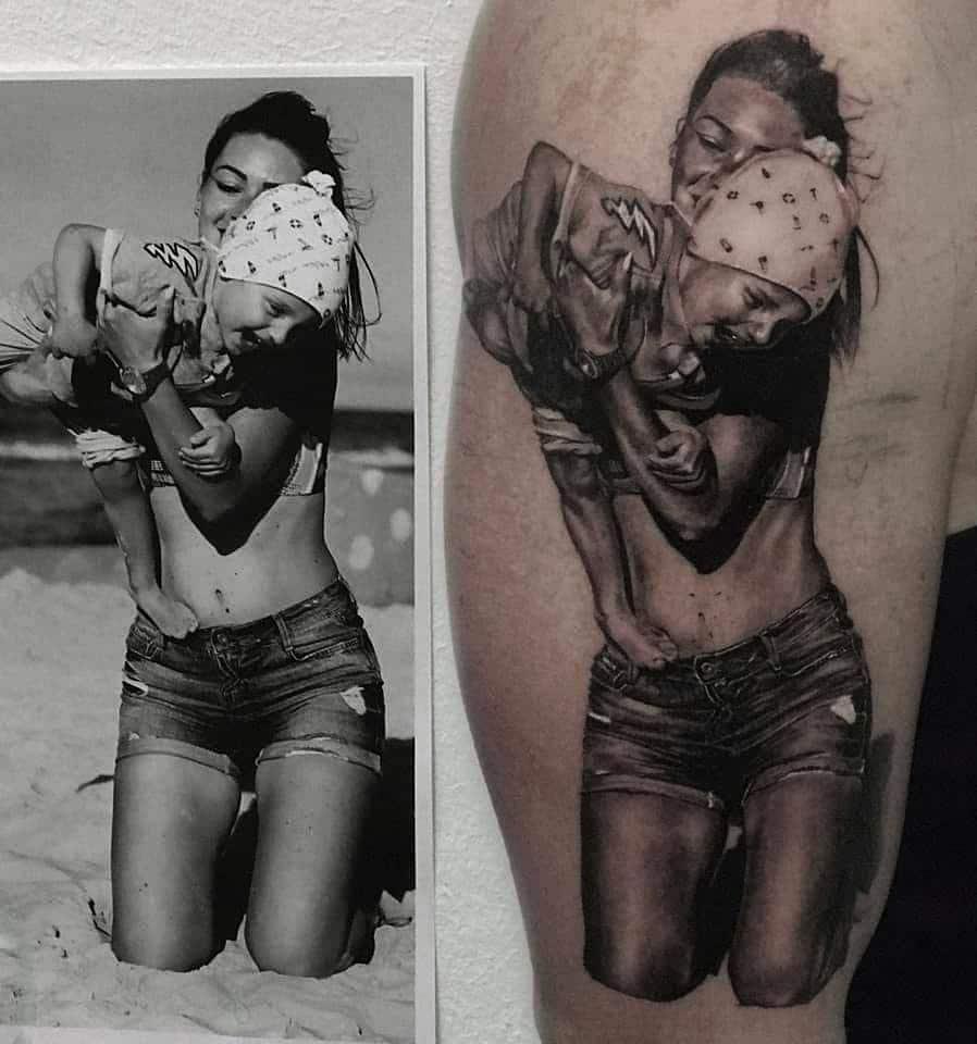 Bild Tattoo eine Frau mit einem Kind